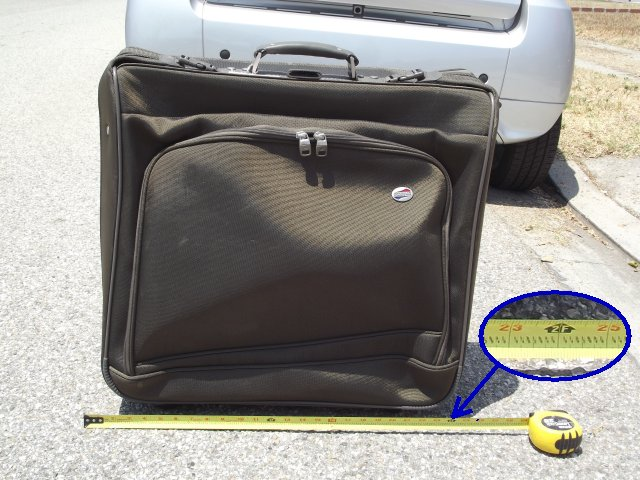 24 inch x 24 inch rolling suitcase